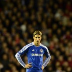 Chelsea's Fernando Torres stands hands on hips as his team are beaten 4-1 by Liverpool, at his old home Anfield, in the Premier League.