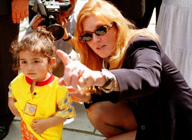 Sarah Ferguson beside a Turkish child during her visit to Turkey in 1998