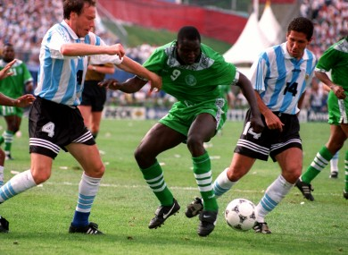Rashidi Yekini of Nigeria battles with Roberto Sensini and Diego Simeone of Argentina.