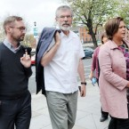 Sinn Fein President Gerry Adams (centre) keeps it casual as he arrived at the High Court this morning with Eoin O Broin (left) and Vice President Mary Lou McDonald
