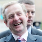 Enda Kenny pictured as he canvasses for a yes vote in tomorrows Fiscal Treaty Referendum outside Pearse St DART Station.