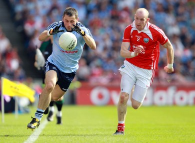Alan Brogan tries to get away from Louth's Eamonn McAuley during the sides' meeting in 2010.