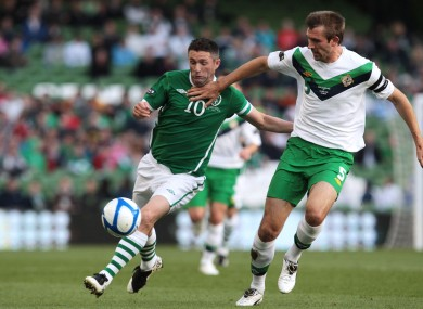 Republic of Ireland's Robbie Keane and Gareth McAuley of Northern Ireland during the Carling Nations Cup in Dublin last summer.