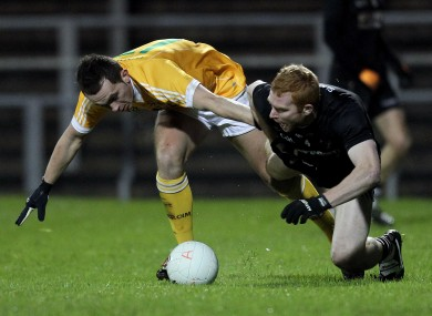Sligo's Ross Donavan, right, battles against Brian Neeson of Antrim during their NFL Division 3 clash.