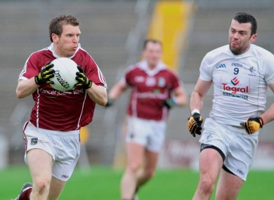 Galway's Kieran McGrath goes up against Padraig O'Neill of Kildare.