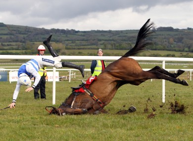 Ruby Walsh falls from Call the Police on the last fence whilst leading the Aon Handicap Steeplechase.
