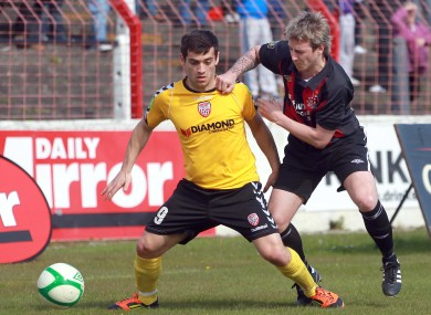 Crusaders' Aidan Watson tussles with David McDaid.