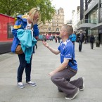 Leinster fan Dave Morris from Wexford gets down on one knee in Leicester Square to propose to his partner of six years, Vickey Ronan. (Mandatory Credit INPHO/Colm O'Neill)