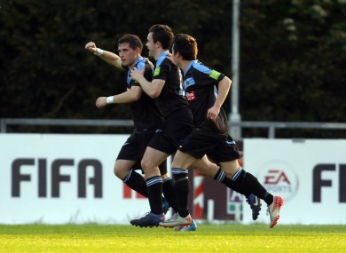 Graham Rusk celebrates UCD's winner with team-mates.