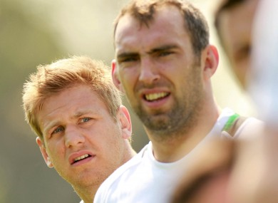 Chris Henry and John Muldoon listen intently
