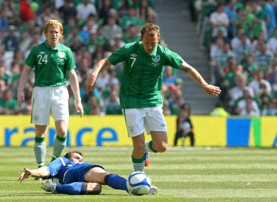 McGeady hurdles the challenge of Senad Lulic.