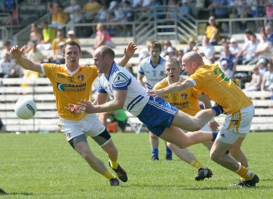 Dick Clerkin of Monaghan under pressure from Michael McCann, Paddy Cunningham and Anto Healey of Antrim.