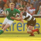 Ireland's Keith Earls tackled by Mick O'Driscoll.