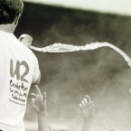 1985: A U2 roadie throws water on fans during a concert in Croke Park in Dublin