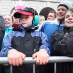 Graham O Reilly (7) from Clonsilla watching Jenson Button go past Custom House in Dublin. 