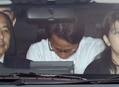Katsuya Takahashi is driven to Tokyo Metropolitan Police Department after being arrested