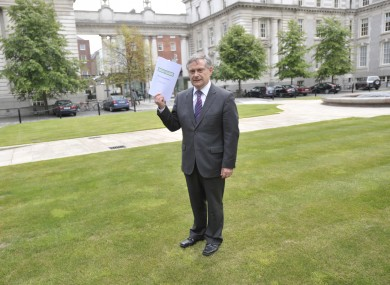 Brendan Howlin holds a copy of the first progress report on the Croke Park Agreement