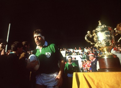 Donal Lenihan jogs out past the Webb Ellis trophy in 1987.