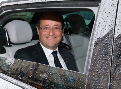 French president Francois Hollande pictured leaving a restaurant in Tulle yesterday