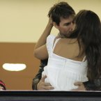 Tom Cruise and Katie Holmes kiss as Cruise's son Connor looks on in their luxury box at a baseball match in California in March 2006 (AP Photo/Ted S. Warren)