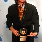 Paul McCartney with 1989 Life Achievement award presented to him at the 32nd annual Grammy Awards in Los Angeles, 22 February, 1990. (AP Photo/Douglas Pizac)