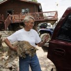 Shirley Paskett loads her stuffed bob cat into her vehicle after she and her partner were evacuated from their home after the High Park wildfire crossed to the north side of Poudre Canyon the Glacier View area near Livermore. (AP Photo/Ed Andrieski)