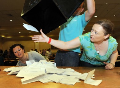 Aoife Sheridan catches a stray vote as boxes are opened at the Dublin City count centre in City West.