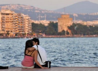 A couple kiss each other at the seaside of Thessaloniki a couple of days ahead of key elections.