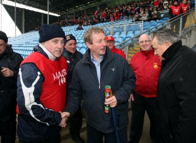 Kenny is greeted upon his arrival yesterday.