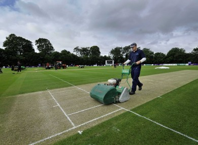 Ground staff get the Stormont crease ready (file photo).