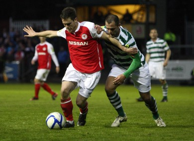 John Russell of St Pat's fends off Chris Turner of Shamrock Rovers during April's league meeting.
