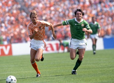 Ireland's Ray Houghton and Adrianus A Van Tiggelen of the Netherlands.