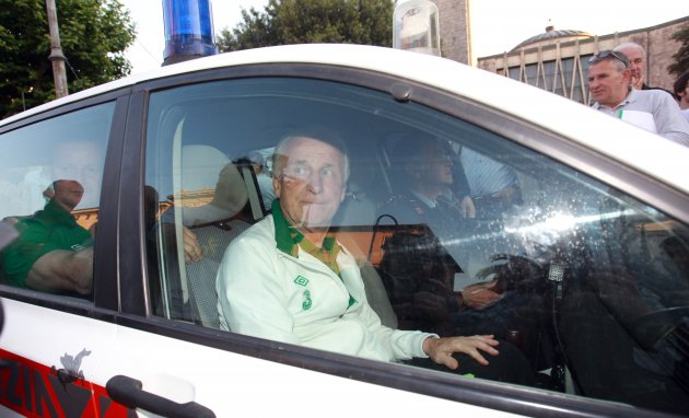 Giovanni Trapattoni is taken away in a police car to avoid the crowds at the reception 2/6/2012