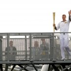 Kilkenny hurler Henry Shefflin with the Olympic torch on the Etihad Skyline at Croke Park.
