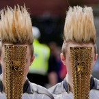 Jedward hide behind their Olympic torches during Wednesday's relay. (©INPHO/Morgan Treacy)