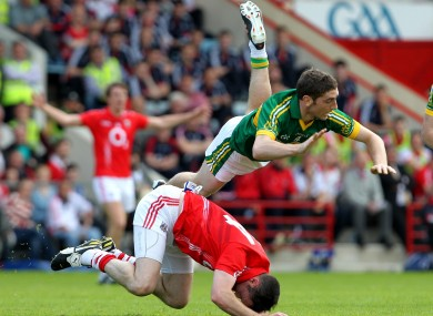 Cork's Donncha O'Connor and Killian Young of Kerry.