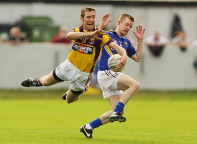 Longford's Declan Reilly and Redmond Barry of Wexford.