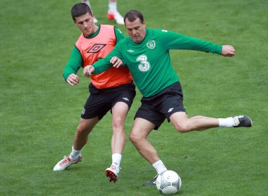 Shane Long and assistant manager Marco Tardelli in training yesterday.
