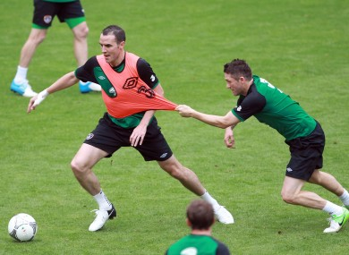 John O'Shea and Robbie Keane tussle in training today in Gdynia.