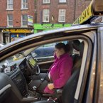 Aideen Carolan watches the Ireland v Spain game on her iPad as  she waits for a customer in her taxi in Drogheda