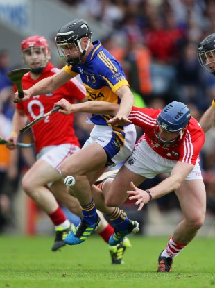 Cork's Patrick Horgan and Paul Curran of Tipperary battle for possession.