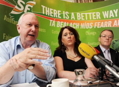 Unite's Jimmy Kelly, single parents activist Louise Bayliss and Sinn Féin's Brian Stanley at a press conference today.