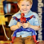 Oliver Martin , three and a half, holds a Spiderman figure, which can fire a motorized web from its hands.
