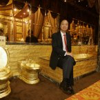 Lam Sai Wing sits in the golden bathroom at the Swisshorn Gold Palace in Hong Kong. (AP Photo/Kin Cheung)