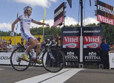 Thibaut Pinot of France crosses the finish line to win the 8th stage of the Tour de France yesterday.