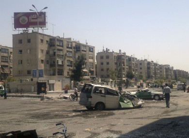This citizen journalist image shows a destroyed vehicles after fighting between rebels and Syrian troops in the Yarmouk camp for Palestinian refugees in south Damascus
