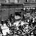 Anti-German demonstrations in Crisp Street, Poplar, London. Anti-German demonstrations in Chrisp Street, Poplar, London in response to the sinking, on 7 May of the liner 'RMS Lusitania' by a German submarine.