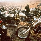 Motorcycles crowd the field at the infamous 
