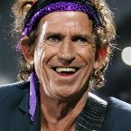 Keith Richards performs during a concert at the Stade de France, north of Paris, in this July 28, 2006.  (AP Photo/Remy de la Mauviniere, File)