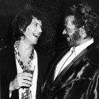 Rock and roll musician Chuck Berry, right, laughs with fellow guitarist Keith Richards of the Rolling Stones at New York's Studio 54, Wednesday night, Feb. 28, 1980.
